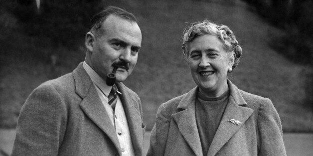 Writer Dame Agatha Christie, and her husband Max E. L. Mallowan, pose in March 1946 in the ground of...