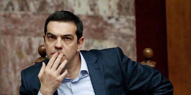 Greece's Prime Minister Alexis Tsipras gestures during a parliamentary session in Athens, on Monday,...
