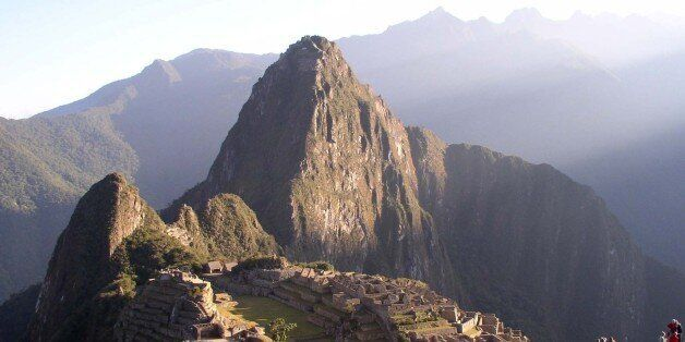 Arrived just in time for the clouds to break and the sun to break on the face of Machu