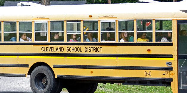 In this May 13, 2015 photo, an integrated group of Cleveland, Miss., public school students ride the...