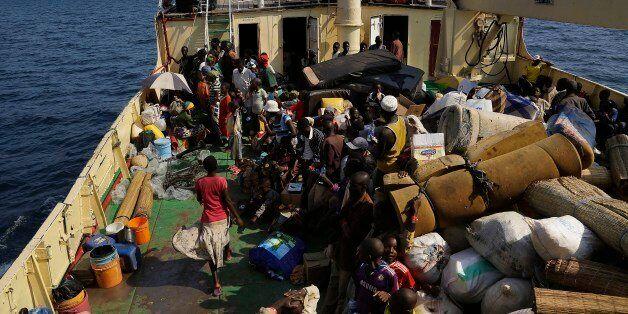 Refugees who fled Burundi's violence and political tension make the journey on Lake Tanganyika, Tanzania...