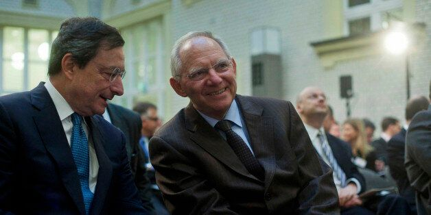 Mario Draghi, left, President of the European Central Bank talks to German Finance Minister Wolfgang...