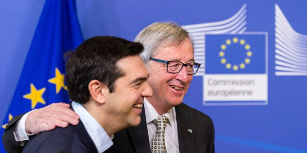 European Commission President Jean-Claude Juncker, right, welcomes Greece's Prime Minister Alexis Tsipras...