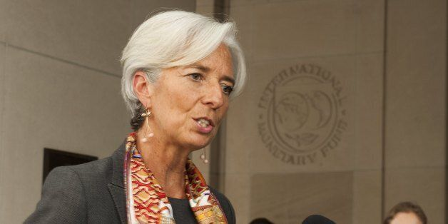 French Finance Minister Christine Lagarde delivers a statement outside the International Monetary Fund...
