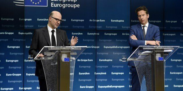 EU Commissioner of Economic an d Financial Affairs, Taxation and Customs Pierre Moscovici (L) and Dutch...