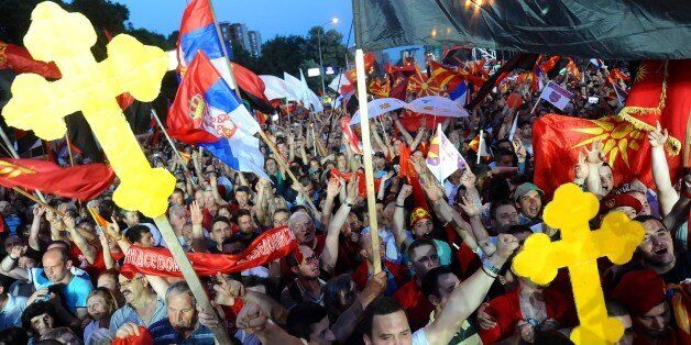 Pro-government demonstrators participate in a rally in the centre of Skopje on May 18, 2015. Some 30,000...