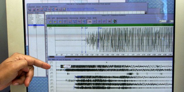 A scientist points to a seismograph reading from this morning's 8.9 earthquake located off the west coast...