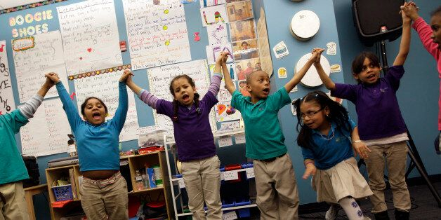 In this April 13, 2011 photo, children take part in a music class at the Mott Haven Academy Charter School,...