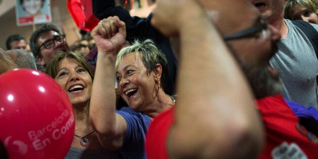 Supporters of the leader of leftist coalition Barcelona Together, Ada Colau, celebrate the victory of...