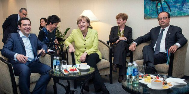 In this photo provided by German government Greek Prime Minister Alexis Tsipras, German Chancellor Angela...