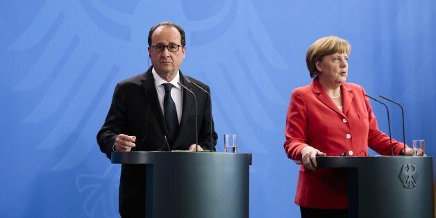 German Chancellor Angela Merkel, right, and French President Francois Hollande brief the media after...