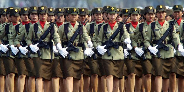 JAKARTA, INDONESIA: Indonesian Army women march during the rehearsal of the 59th anniversary of the creation...