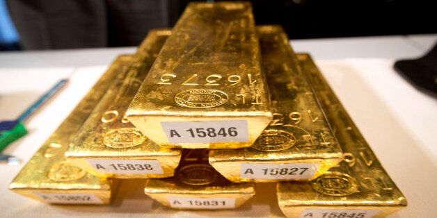Bars of gold are piled up during a press conference at the German Federal Bank in Frankfurt am Main,...