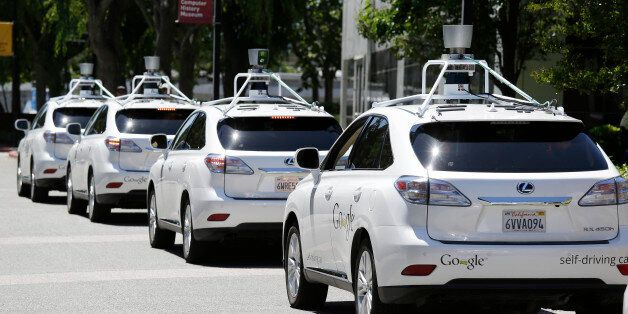 FILE - This file photo taken Tuesday, May 13, 2014 shows a row of Google self-driving cars outside the...