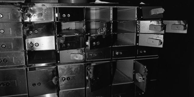 Damaged and empty safe deposit boxes following a robbery. (Photo by Evening Standard/Getty