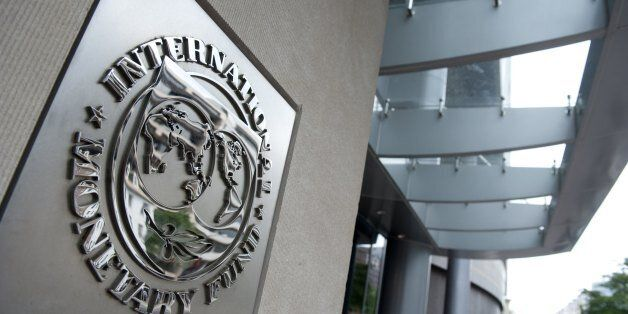 The logo of the International Monetary Fund(IMF) is seen shortly after Christine Lagarde, Managing Director,...
