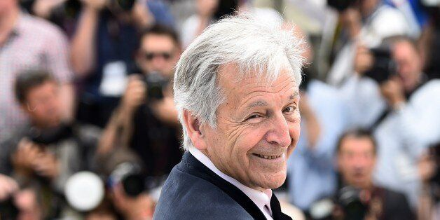 Greek director Costa-Gavras smiles during a photocall for the sidebar section 'Cannes Classics' at the...