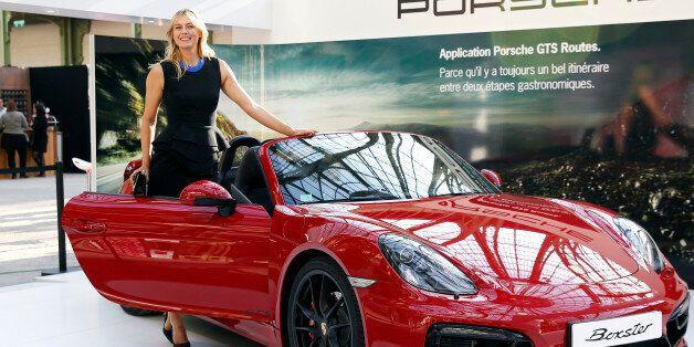 PARIS, FRANCE - MAY 21: Porsche Brand Ambassador Maria Sharapova poses next to a Porsche model at the...