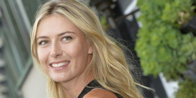 Russina tennis player Maria Sharapova poses during a photocall in Paris on May 18, 2015. AFP PHOTO/MIGUEL...