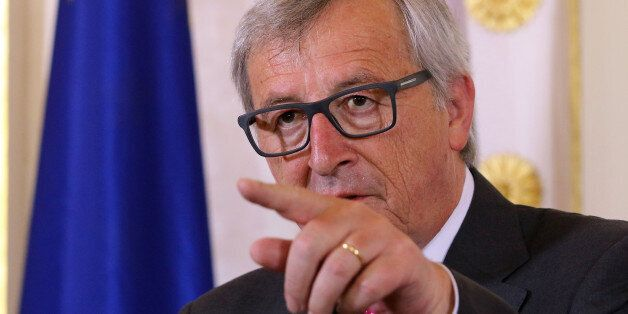 European Commission President Jean-Claude Juncker gestures as he attends a press conference after talks...