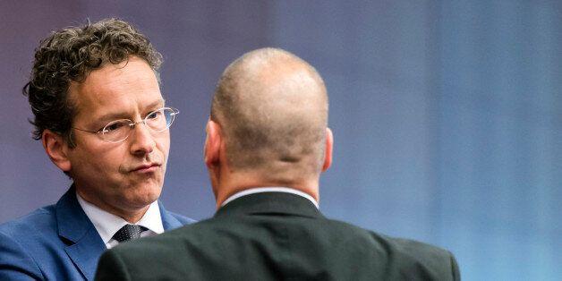 Dutch Finance Minister Jeroen Dijsselbloem, left, speaks with Greek Finance Minister Yanis Varoufakis...