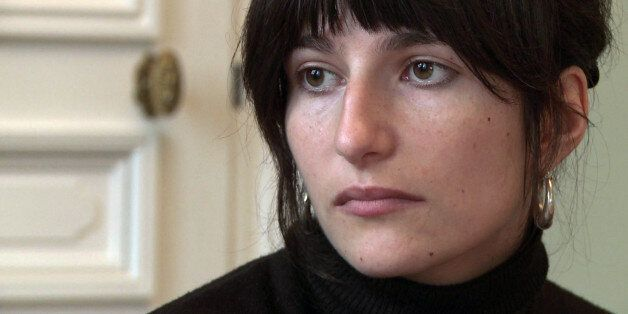 A grab taken from an AFP video shows Marion Larat, 25, on December 14, 2012 in her lawyers' office in Bordeaux, southwestern France. Victim of a stroke, that she attributes to her so-called third generation contraception pill, Marion Larat, disabled at 65% since her stroke, decided to lodge a complaint against the CEO of German chemical and pharmaceutical company Bayer for 'unintentional violation of integrity of the human person'. AFP PHOTO        (Photo credit should read -/AFP/Getty Images)