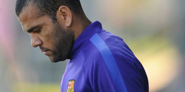 Barcelona's Dani Alves, from Brazil, looks down during a training session at the Sports Center FC Barcelona...
