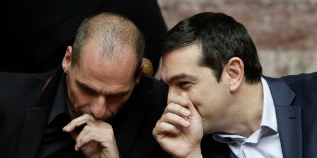 Greece's Prime Minister Alexis Tsipras talks with Greece's Finance Minister Yanis Varoufakis, left, during...