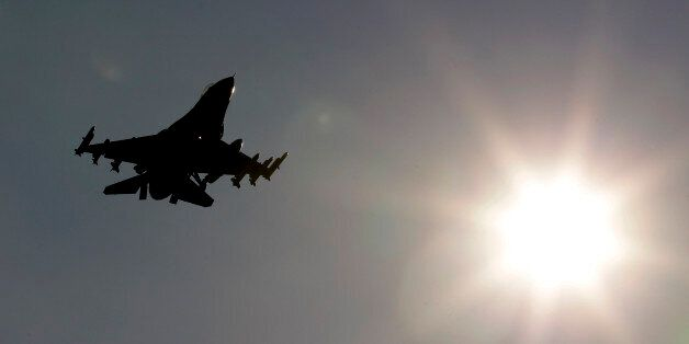 An F-16 jet fighter flies over the NATO airbase in Aviano, Italy, Monday, March 21, 2011. Italy is warning...