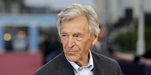 Greek-French film director Costa-Gavras poses on the red carpet before the screening of the movie 'Camp...