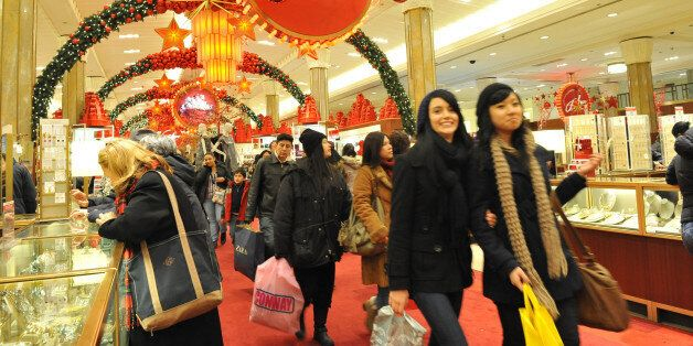 Shoppers are seen inside of Macy's flagship store at New York City's Herald Square, Sunday, Dec. 20,...