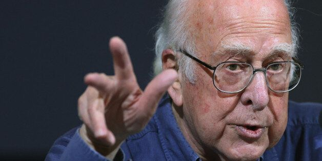 Britain's Professor Peter Higgs gestures, during a press conference, in Edinburgh, Scotland Friday, Oct....