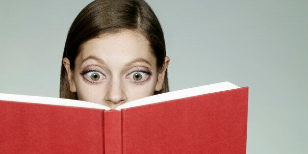 Woman with big eyes reading book