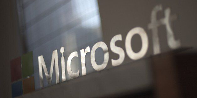 The Microsoft logo is seen before the start of a media event in San Francisco, California on Thursday,...