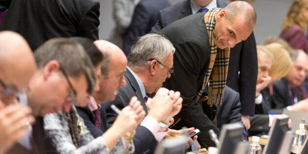 Greek Finance Minister Yanis Varoufakis, fourth right, takes his seat during a meeting of eurogroup finance...