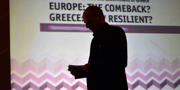 Greek finance minister Yianis Varoufakis stands prior to deliver a speech during the Economist conference...