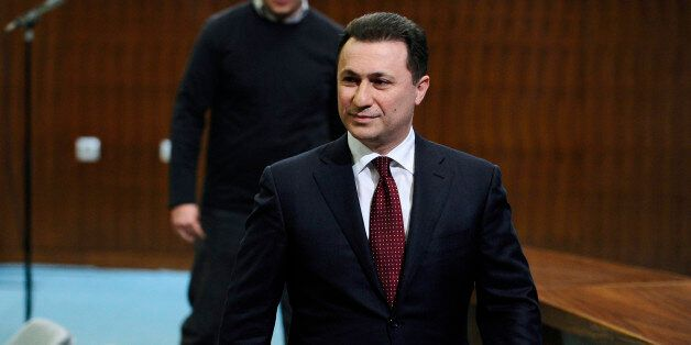 Macedonian Prime Minister Nikola Gruevski walks after a news conference at the government building in...