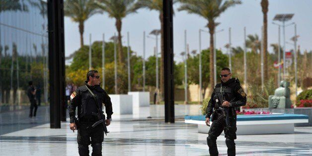 Egyptian police stand guard as ministers and attendees arrive for the Arab foreign ministers conference...