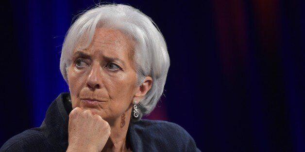 International Monetary Fund Managing Director Christine Lagarde listens as Federal Reserve Board Chairwoman...