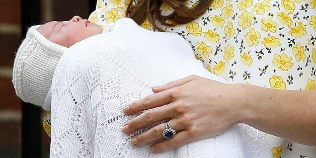FILE - In this  Saturday, May 2, 2015. file photo, Kate Duchess of Cambridge holds her newborn baby princess as they leave The Lindo Wing of St. Mary's Hospital, in London  Britain's newborn princess has been named Charlotte Elizabeth Diana it was announced on Monday May 4. (AP Photo/Kirsty Wigglesworth, File)