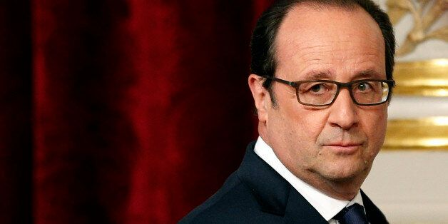 French President Francois Hollande arrives for a press conference with U.N. Secretary-General Ban Ki-moon,...