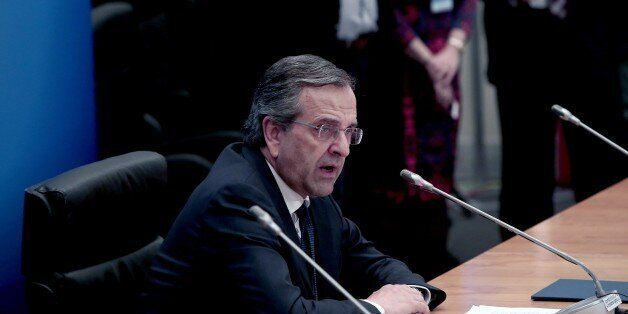 Greek prime minister Antonis Samaras delivers his statement to the press the Zappeion hall after general...