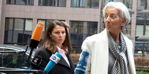 Managing Director of the International Monetary Fund Christine Lagarde, right, arrives for a meeting...