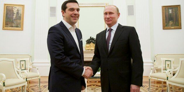Russian President Vladimir Putin, right, welcomes visiting Greek Prime Minister Alexis Tsipras in Moscow's...
