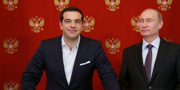Russian President Vladimir Putin, right, and Greek Prime Minister Alexis Tsipras attend a signing ceremony...