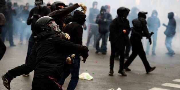 Protestors face off against police during a demonstration against Milan's Universal Exposition, EXPO2015,...