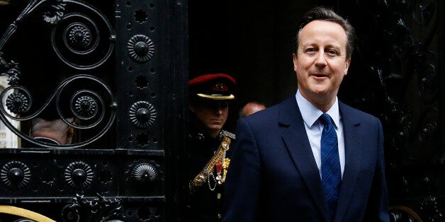 Britain's Prime Minister David Cameron returns to 10 Downing Street in London after attending a VE Day...