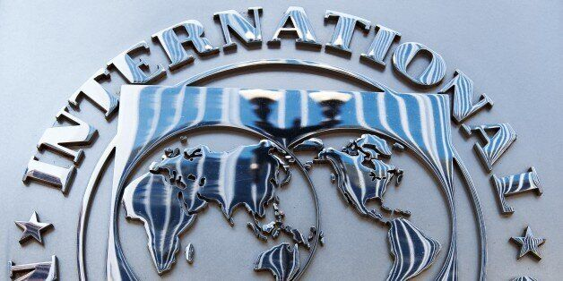The logo of the International Monetary Fund (IMF) is seen shortly after Christine Lagarde, Managing Director,...