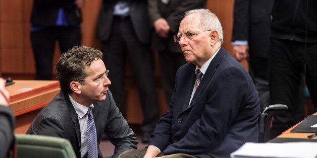 German Finance Minister Wolfgang Schaeuble, right, speaks with Dutch Finance Minister Jeroen Dijsselbloem...