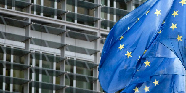 EU flags flap in the wind outside EU headquarters in Brussels on Monday, Feb. 2, 2015. Due to a heightened...